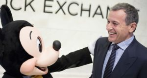 epa06354219 Bob Iger (R), the CEO of The Walt Disney Company, and company mascot Mickey Mouse stand together before ringing the opening bell of the New York Stock Exchange in New York, New York, USA, on 27 November 2017.  EPA/JUSTIN LANE