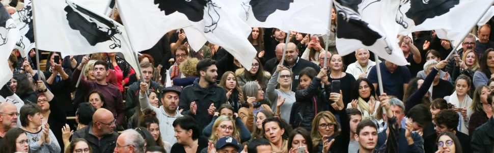 epa06358399 Supporters wave Corsican flags during a campaign meeting of the 'Pe a Corsica' (lit. Pour la Corse / eng. For Corsica) nationalist list ahead of the territorial elections in Corte, Corsica island, France, 29 November 2017. The elections will take place on 03 and 10 December in Corsica island.  EPA/OLIVIER SANCHEZ